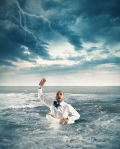Businessman in the ocean asking for help