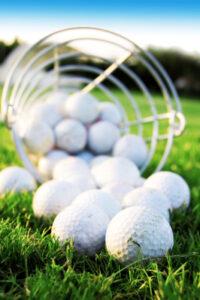 Golf balls falling out of basket