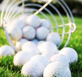 Golf balls falling out of basket