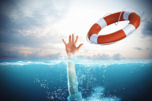 Save Your Corporate Culture with Carol Ring Lifesaver launched a drowning man in the sea