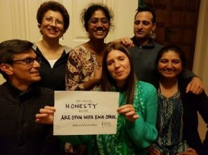 Worlds Value Day Picture with People Holding Honesty Sign
